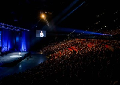 Michael Crossland talking in front of 6000 people at the International Convention Centre Sydney